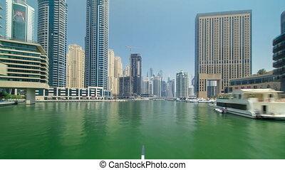 Boat trip on the ship-restaurant by the channel in Dubai Marina. Dubai, UAE timelapse hyperlapse part 1