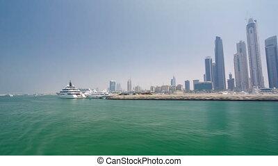 Boat trip on the ship-restaurant by the channel in Dubai Marina. Dubai, UAE timelapse hyperlapse