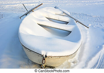 Boat under the snow at winter