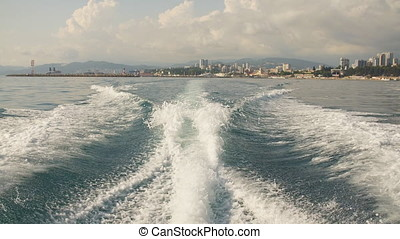 Boat wake as it leaves the port, slow motion.