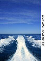 Boat white wake on the blue ocean sea