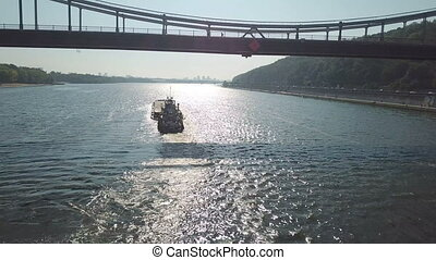 Boat with a barge on the river Dnieper - Towing boat pulls a...
