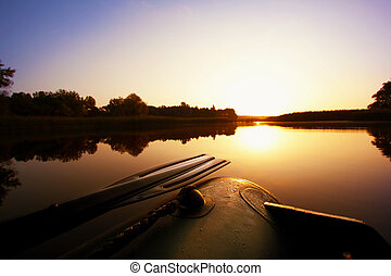 Boat with a paddle on the lake
