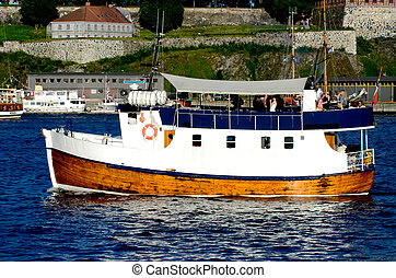 Boat with Akershus Fortress Oslo Norway