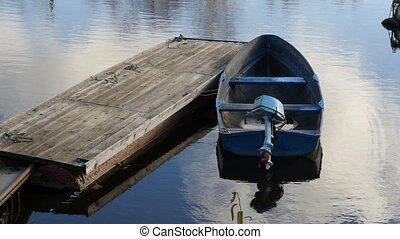 boat with an outboard motor moored