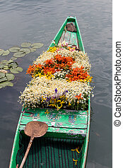 Boat with flowers on lake