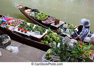 Boat with fruits on floating market in Bangkok