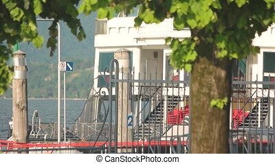 Boat with Italian naval flag. Lake Maggiore, water...