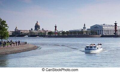 Boat with passengers floats near Strelka Vasilievsky island...