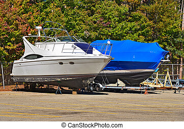 boat with shrink wrap - Power boat with blue shrink wrap.
