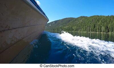 Boat with wake in river 4k - Boat with wake in river on a...