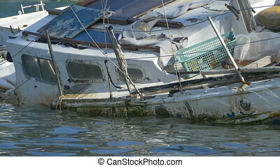 Boat Wreck on Sea - A sailboat wreck in the sea waters.