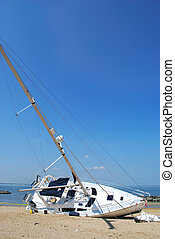Boat Wreck - sailboat beached after a storm