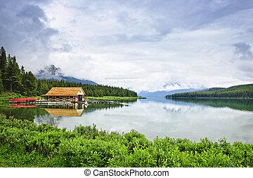 Boathouse on mountain lake - Canoes at boathouse on Maligne...