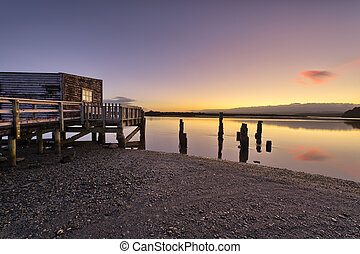 Boathouse on the shores of Okarito Lake