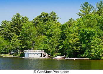 Boathouse with a boat at the dock