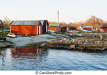 Boathouses on rock
