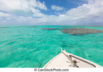 boating in aitutaki lagoon, cook islands
