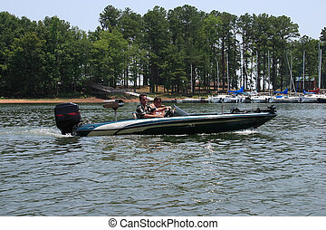 Boating Fun - Young couple enjoying a day on the lake