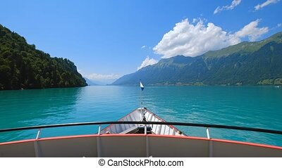 Boating on Brienz lake at summer in Switzerland