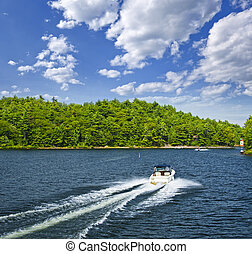 Boating on lake - Motorboat on summer lake in Georgian Bay,...