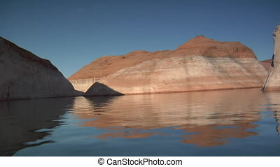 boating up watery red canyons Lake Powell Utah