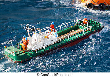 boatman working on deck supply boat, crews operation on installation boat, heavy job in offshore.