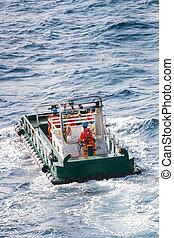 boatman working on deck supply boat