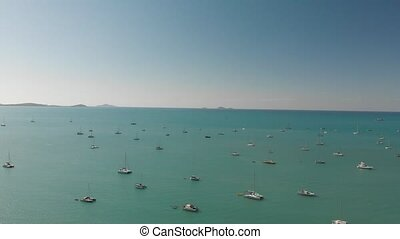Boats anchored in a beautiful bay, aerial view from drone.