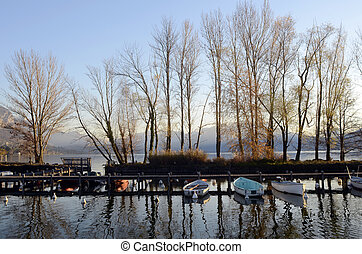 Boats and Annecy lake landscape in France