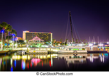Boats and buildings at night, in Long Beach, California.