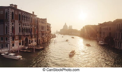 Boats and buildings on the Grand Channel at sunrise, Venice,...