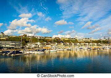 Boats and houses along Beacon Bay, in Newport Beach, California.