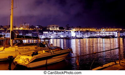 boats and yachts at night, in the harbour of mahon, menorca,...
