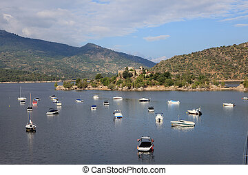 Boats and yachts in the Burguillo Reservoir. Iruelas Valley Natural Reserve, Avila, province Castilla y Leon, Spain