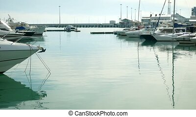 Boats and yachts in the marina at noon