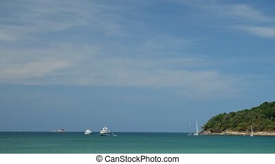 boats and yachts sail in azure ocean near tropical island - ...