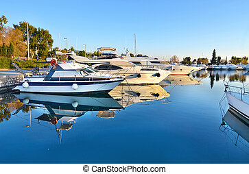 boat reflection on sea at Alimos Attica Greece