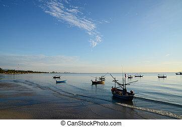 Boats at fishing pier in Hua Hin, Thailand.
