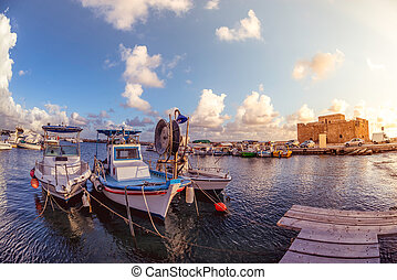 Boats at Paphos harbor with the castle on the background. Cyprus