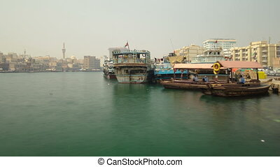 Boats at Port Saeed along Deira's shore of Dubai Creek, UAE. Timelapse