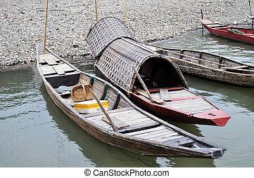 Boats at river bank