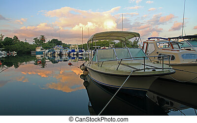 Boats at Sunrise, in Calm Water