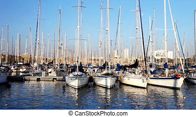 boats at sunset in a port in Barcelona, spain