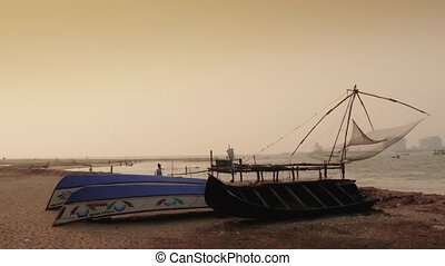 Boats at sunset on beach