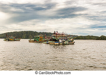 Boats at the bay in Kota Kinabalu, Northern Borneo, Malaysia.