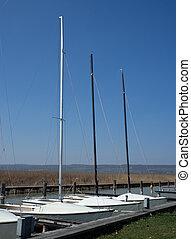 Boats at the jetty at a lake