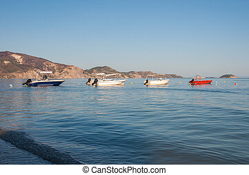 Boats at the Laganas beach in afternoon sun