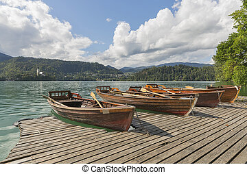 Boats at the pier of Lake Bled.