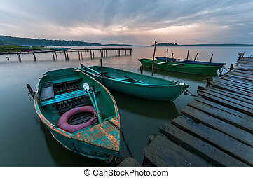 boats at the pier on the lake